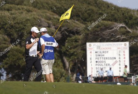 Rory Mcilroy of Ireland (l) Talks with His Caddie J P Fitzgerald (r) As His Name is Posted at the Top of the Leaderboard on the Eighth Green During the Third Day of the Pga Championship on the Ocean Course at Kiawah Island South Carolina Usa 11 August 2012 United States Kiawah Island