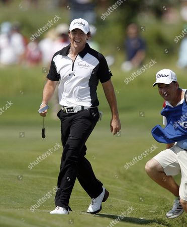 Rory Mcilroy of Ireland (l) and His Caddie J P Fitzgerald (r) Smile As They Walk to the Green and See where is Tee Shot Landed on the Fifth Hole During the Third Day of the Pga Championship on the Ocean Course at Kiawah Island South Carolina Usa 11 August 2012 United States Kiawah Island