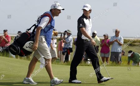 Rory Mcilroy of Ireland (r) Talks with His Caddie J P Fitzgerald (l) As They Walk in the Fairway on the Eighth Hole During the Third Day of the Pga Championship on the Ocean Course at Kiawah Island South Carolina Usa 11 August 2012 United States Kiawah Island