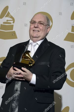 Stock Photo of Us Singer Billy Vera Holds His Award For Best Album Notes at the 55th Annual Grammy Awards in Los Angeles California Usa 10 February 2013 United States Los Angeles