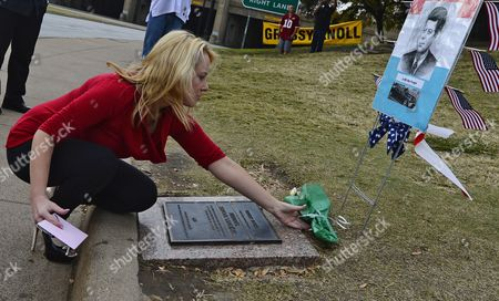 Jane Kennedy Lays a Flower in Front of a Temporary Memorial For Jfk at Dealey Plaza on the 49th Anniversary of the Shooting and Death of John F Kennedy the 35th President of the United States on Thanksgiving in Dallas Texas Usa 22 November 2012 the City of Dallas Will Host a Public Memorial to Honor the 35th President of the United States John F Kennedy on 22 November 2013 at Dealey Plaza Outside the Book Depository Building on the 50th Anniversary of President John F Kennedy Death United States Dallas