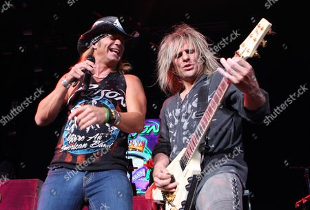 Bret Michaels (l) and C C Deville of Us Band Poison Perform at Klipsch Music Center in Indianapolis Indiana 24 August 2012 United States Indianapolis