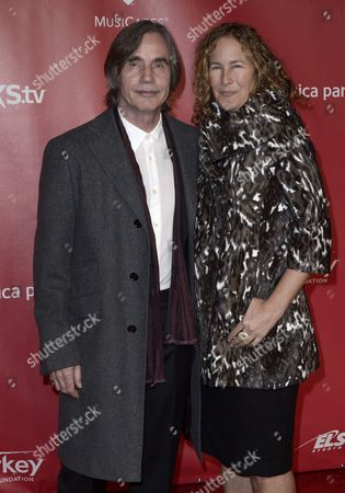 Us Musician Jackson Browne (l) and Dianna Cohen (r) Arrive For the 2013 Musicares Person of the Year Gala Honoring Bruce Springsteen in Los Angeles California Usa 08 February 2013 United States Los Angeles