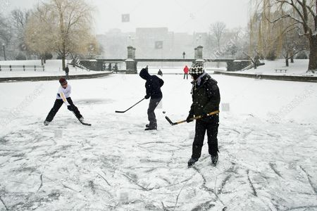 Andreas Frank (blue) Louis Lapsley (green) Jackson Greeley (white) Play Ice Hockey on the Duck Pond in the Public Garden in Boston Massachusetts Usa 08 February 2013 the National Weather Service Has Predicted the Storm Will Dump More Than Two to Three Feet (60cm-90cm) of Snow on the State of Massachusetts Between 08 February and 09 February and with Lesser But Still Large Amounts of Snowfall in the Entire New York/new England Area United States Boston