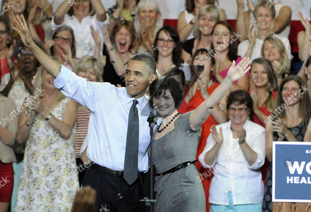 Us President Barak Obama and Sandra Fluke Wave to the Crowd After She Introduced Him at the Auraria Event Center in Denver Colorado Usa 08 August 2012 Fluke is the Georgetown University Student who Gained Notoriety After Conservative Talk Show Host Rush Limbaugh Called Her a Slut Because of Her Support For a Portion in the President's Health Care Overhaul That Requires Insurance Companies to Cover Contraception United States Denver