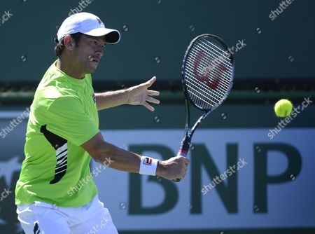 Bjoern Phau of Germany Returns a Shot to Jeremy Chardy of France During Their Match at Bnp Paribas Open Tennis Tournament in Indian Wells California Usa 10 March 2013 United States Indian Wells
