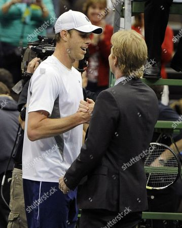Sam Querrey (l) of the United States Celebrates with Team Captain Jim Courier (r) Following His Win Over Thiago Alves of Brazil During the Deciding Rubber Match of the Davis Cup 2013 World Group First Round Between the United States and Brazil in Jacksonville Florida Usa 03 February 2013 United States Jacksonville