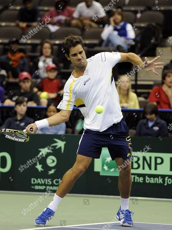 Thiago Alves of Brazil Returns to Sam Querrey of the United States During the Deciding Rubber Match of the Davis Cup 2013 World Group First Round Between the United States and Brazil in Jacksonville Florida Usa 03 February 2013 United States Jacksonville