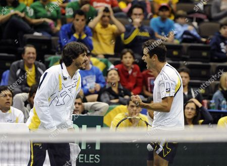 Thiago Alves (r) of Brazil Celebrates with Brazil Team Captain Joao Zwetsch (l) While Taking on Sam Querrey of the United States During the Deciding Rubber Match of the Davis Cup 2013 World Group First Round Between the United States and Brazil in Jacksonville Florida Usa 03 February 2013 United States Jacksonville