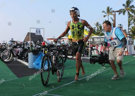 Chris Mccormack of Australia Races Through the Transition Area to Begin the 112 Mile Biking Leg of the Triathlon Ironman World Championship in Kailua-kona Hawaii Usa 13 October 2012 United States Kailua-kona