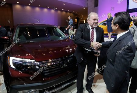 President and CEO of Honda North America John Mendel is congratulated after the Honda Ridgeline won the truck of the year at the North American International Auto show, in Detroit