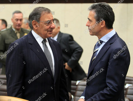 Nato Secretary General Anders Fogh Rasmussen (r) Chats with Us Defence Secretary Leon Panetta (l) During a Meeting on the Second Day of a Nato Defence Ministers Council at the Alliance's Headquarters in Brussels Belgium 10 October 2012 a Surge This Year in Attacks by Uniformed Afghans on Foreign Soldiers was Due to Dominate the Meeting of Nato Defence Ministers As the Military Alliance Works to Help Stabilize Afghanistan Ahead of a 2014 Pullout of Combat Troops E Belgium Brussels