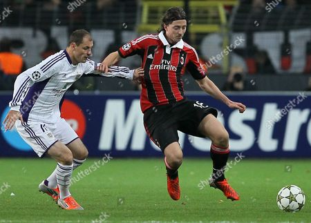 Rsc Anderlecht's Milan Jovanovic (l) and Milan's Riccardo Montolivo (r) Fight For the Ball During the Uefa Champions League Group C Soccer Match Between Rsc Anderlecht and Ac Milan at the Constant Vanden Stock Stadium in Brussels Belgium 21 November 2012 Belgium Brussels