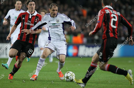 Milan's Riccardo Montolivo (l) and Rsc Anderlecht's Milan Jovanovic (r) Fight For the Ball During the Uefa Champions League Group C Soccer Match Between Rsc Anderlecht and Ac Milan at the Constant Vanden Stock Stadium in Brussels Belgium 21 November 2012 Belgium Brussels