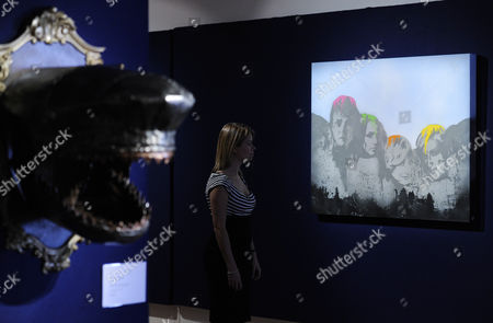 A Bonhams Employee Poses For Photographs in Front of the Artwork '21 Century Presidents' by British Artist Nick Walker During the Bonhams Urban Art Sale Preview in London Britain 09 August 2012 a Striking Selection of Urban Art From Banksy Bleck Le Rat Nick Walker Among Other Artists is Presented Ahead of the Los Angeles Art Urban Sale on 29 October 2012 United Kingdom London