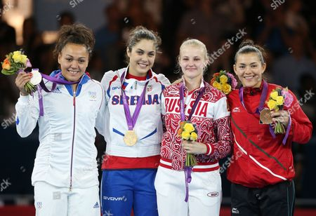 Stock Photo of (r-l) Maria Del Rosario Espinoza of Mexico and Anastasia Baryshnikova of Russia (bronze) Milica Mandic of Serbia (gold) and Anne-caroline Graffe of France (silver) From the Women +67kg Gold Medal Final Taekwondo at the Excel Centre in the London 2012 Olympic Games 11 August 2012 United Kingdom London