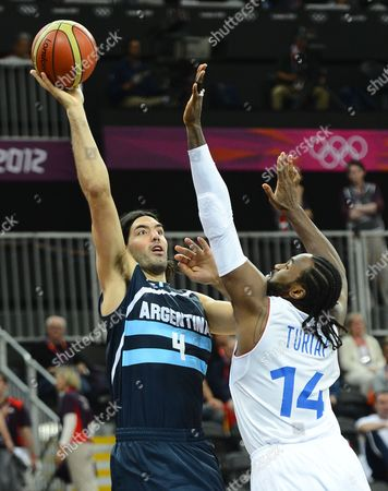 Argentina Player Luis Scola (l) Takes a Shot Against France Player Ronny Turiaf (r) During the Preliminary Round Match Between Argentina and France in the London 2012 Olympic Games Basketball Competition London Britain 31 July 2012 United Kingdom London
