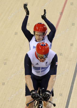 Great Britain's Neil Fachie and Barney Storey Celebrate Winning Gold During the Men's Individual B 1 Kilometer Time Trial Cycling Final at the Velodrome at the Olympic Park During the London 2012 Paralympic Games in London 01 September 2012 United Kingdom London