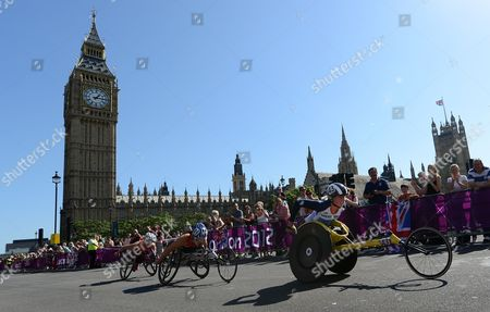 Stock Photo of Britain's Shelly Woods (r) Passes the Houses of Parliament in Westminster on Her Way to Win the Silver Medal in the Women's T-54 Marathon During the London 2012 Paralympic Games in London Britain 09 September 2012 United Kingdom London