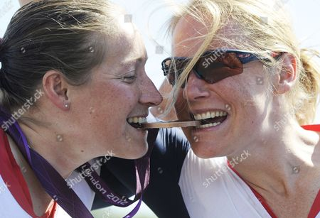 Britain's Rachel Morris (l) Bites Her Bronze Medal with Team Mate (and 4th Place) Britain's Karen Darke (r) at the End of the Women's Individual H1-3 Road Race in Brands Hatch During the London 2012 Paralympic Games in London Britain 07 September 2012 United Kingdom London