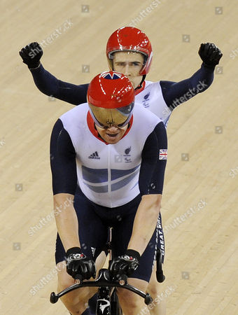 Great Britain's Neil Fachie and Barney Storey Celebrate Winning Gold During the Men's Individual B 1km Time Trial Cycling Final at the Velodrome at the Olympic Park During the London 2012 Paralympic Games in London Britain 01 September 2012 United Kingdom London