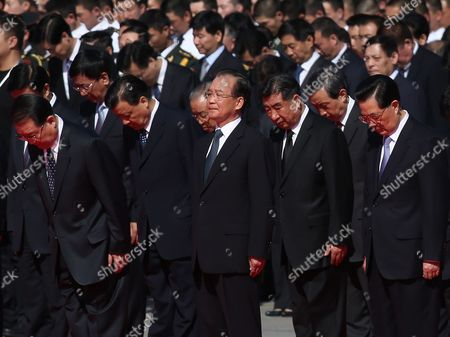 Stock Photo of (front L-r) Chinese Propaganda Chief Li Changchun Premier Wen Jiabao and President Hu Jintao Attend a Flower Laying Ceremony at the Monument to the People's Heroes to Mark National Day on Tiananmen Square in Beijing China 01 October 2012 China's Ruling Communist Party on 28 September Said It Planned to Open a Five-yearly Congress on 08 November to Approve Its First Leadership Changes For a Decade the Crucial Party Congress is Expected to Approve Successors to Current Party Leader and State President Hu Jintao State Premier Wen Jiabao and Other Senior Figures who Will Retire China Beijing