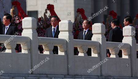 (l-r) Chinese President Hu Jintao Chairman and Party Secretary of the Standing Committee of the National People's Congress Wu Bangguo Premier Wen Jiabao Propaganda Chief Li Changchun Vice-president Xi Jinping Walks Along the Monument to the People's Heroes During a Flower Laying Ceremony to Mark National Day on Tiananmen Square in Beijing China 01 October 2012 China's Ruling Communist Party on 28 September Said It Planned to Open a Five-yearly Congress on 08 November to Approve Its First Leadership Changes For a Decade the Crucial Party Congress is Expected to Approve Successors to Current Party Leader and State President Hu Jintao State Premier Wen Jiabao and Other Senior Figures who Will Retire China Beijing
