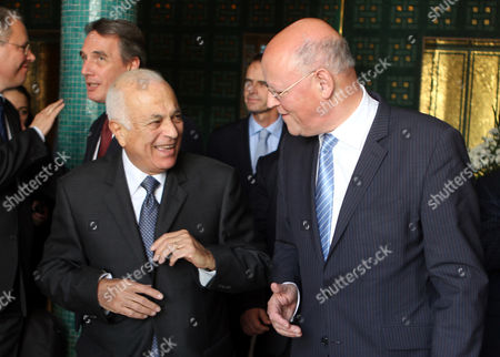 Stock Image of Arab League General Secretary Nabil Alaraby (l) Smiles with Minister of Foreign Affairs of the Netherlands Uri Rosenthal (r) at the Arab League's Headquarters in Cairo Egypt 21 October 2012 Egypt Cairo