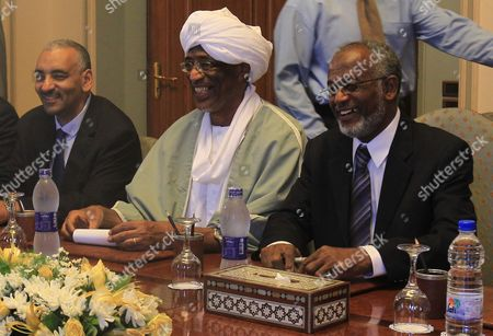 Sudanese Foreign Minister Ali Karti (r) Smiles with Other Unidentified Members of the Sudanese Delegation During a Meeting with His Egyptian Counterpart Kamel Amr (not Pictured) at the Arab League Headquarter in Cairo Egypt 25 August 2012 Karti Had Met with Egyptian President Mohamed Morsi Earlier During the Day Egypt Cairo
