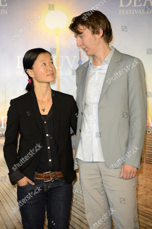 Us Director So Yong Kim (l) and Us Actor Paul Dano (r) Pose For Photographers at the Photocall For 'For Ellen' During the 38th Deauville American Film Festival in Deauville France 01 September 2012 France Deauville