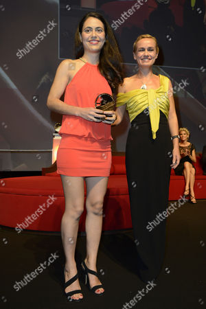 Us Director Lucy Mulloy Poses with Her 'Jury Prize' Award and Jury President Sandrine Bonnaire (r) During the Closing Ceremony of the 38th Deauville American Film Festival in Deauville France 08 September 2012 France Deauville