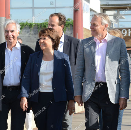 Stock Picture of French Prime Minister Jean-marc Ayrault (r) Socialist Party First Secretary Martine Aubry (c) and French Socialist Party Member and Mayor of La Rochelle Maxime Bono (l) Arrive to Attend the Meeting During the Last Day of the Annual Party's 'Summer University' in La Rochelle France 26 August 2012 where Party Leaders and Members Come Together to Discuss Future Strategies Few Weeks Ahead of the Election of the French Socialist Party's New First Secretary France La Rochelle