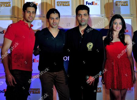 Bollywood Actor Sidharth Malhotra (l) Bollywood Actor Varun Dhawan (2-l) Director Karan Johar (2-r) and Bollywood Actress Alia Bhatt Pose For the Photographs During the Promotional Event of Their Upcoming Bollywood Hindi Movie 'Student of the Year' in Southern Indian City of Bangalore 08 October 2012 India Bangalore