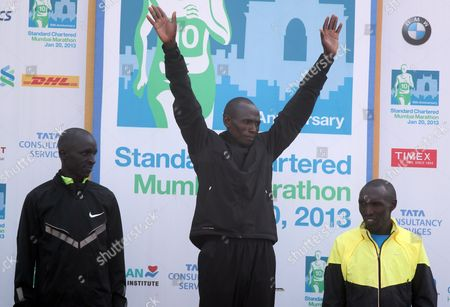 Winner Jackson Kiprop (c) of Uganda Second Placed Ethiopian Jacob Cheshari (l) and Third Placed Kenyan Elijah Kemboi (r) Pose on the Podium After the Finish of the 10th Edition of Standard Chartered Mumbai Marathon 2013 in Mumbai India 20 January 2013 a Total 38 620 Participants From the City Elsewhere in the Country Foreigners Handicapped Senior Citizens Students and Other Groups Raced Their Way in Different Categories India Mumbai