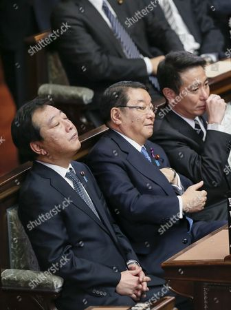 Stock Picture of Japanese Prime Minister Yoshihiko Noda (l) Attends the General Assembly with Chief Cabinet Secretary Osamu Fujimura (2nd L) and Seiji Maehara (r) Minister For National Policy at Japan's Lower House in Tokyo Japan 16 November 2012 Noda Talked in a Parliamentary Debate November 14 with the Biggest Opposition Liberal Democratic Party President Shinzo Abe That He Would Dissolve the Lower House on November 16 if Opposition Parties Would Agree Electoral Reforms Foreign Minister Koichiro Gemba is in Right and Chief Cabinet Secretary Osamu Fujimura is Seen in the Second Left in Bottom Japan Tokyo