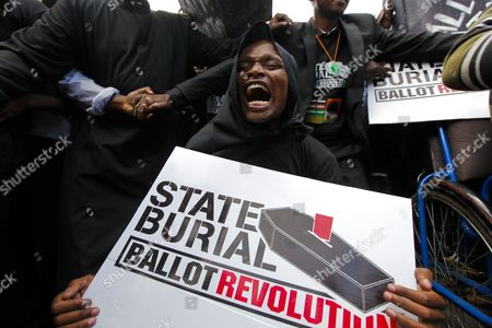 A Kenyan Activist Reacts During a Demonstration to Protest Against Lawmakers who Passed the Bill to Award Themselves Some 110 000 Us Dollars (82 887 Euro) Sendoff Bonus in Nairobi Kenya 16 January 2013 on Top of a Hefty Bonus the Proposed Bill Would Have Granted Outgoing Members of Parliament who Are Already Some of the Best Paid on the Continent Bodyguards For Life Diplomatic Passports Unlimited Access to the Vip Lounges at All Kenyan Airports and State Funerals Kenyan President Mwai Kibaki Has Declined to Assent to the Bill While Approving a Bill Awarding Himself Almost 300 000 Us Dollars (226 044 Euro) Sendoff Package Kenya Nairobi