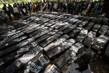 Kenyan Activists Line Up Hundreds of Mock Coffins During a Demonstration to Protest Against Lawmakers who Passed the Bill to Award Themselves Some 110 000 Us Dollars Sendoff Bonus in Nairobi Kenya 16 January 2013 on Top of a Hefty Bonus the Proposed Bill Would Have Granted Outgoing Members of Parliament who Are Already Some of the Best Paid on the Continent Bodyguards For Life Diplomatic Passports Unlimited Access to the Vip Lounges at All Kenyan Airports and State Funerals Kenyan President Mwai Kibaki Has Declined to Assent to the Bill While Approving a Bill Awarding Himself Almost 300 000 Us Dollars Sendoff Package Kenya Nairobi