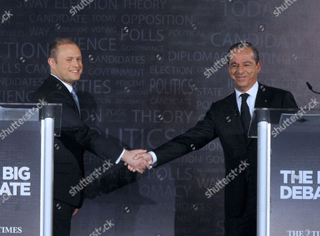 Dr Joseph Muscat (l) Leader of Maltese Labour Party Shakes Hands with Dr Lawrence Gonzi of the Nationalist Party at the End of Their Televised Election Debate Valletta Malta 26 February 2013 Maltese Voters Go to Polls in General Elections 09 March 2013 the Debate was Organized by Maltese English Language Newspaper the Times Malta Valletta