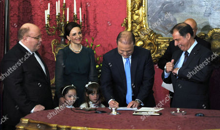 Dr Joseph Muscat (c) Labour Party Leader and Prime Minister of Malta Alongside His Wife and Children Takes the Oath in the Presence of Attorney General Dr Peter Grech (l) and President George Abela (r) at the Presidential Palace in Valletta Malta 11 March 2013 Muscat Won the Election on 09 March with a 55% Majority Malta Valletta