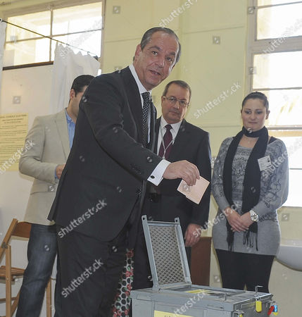 Stock Image of Former Prime Minister and Nationalist Party Leader Lawrence Gonzi Casts His Vote at a Primary School Polling Station in Marsascala Village Near Valletta Malta 9 March 2013 As the Island Nation Votes in General Elections the Result is Expected 10 March Malta Valletta