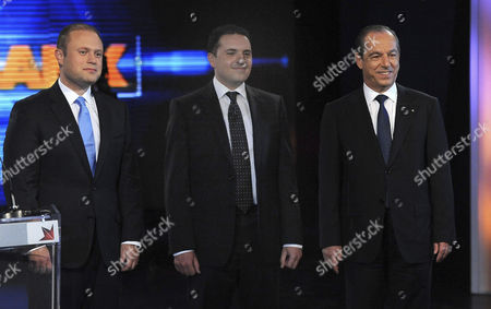(l-r) Joseph Muscat Leader of Malta's Labor Party Michael Briguglio Leader of the Green Party and Incumbent Prime Minister Lawrence Gonzi of Malta's Nationalist Party Pose Prior a Political Debate on Malta's Popular Tv Show Xarabank where the Main Candidates Present Their Platforms in Valletta Malta 01 March 2013 Maltese Voters Will Go to the Polls in General Elections on 09 March 2013 Malta Valletta