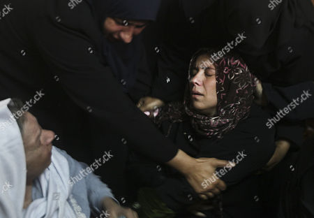 Palestinian Mother of Audi Naser 10 Years (r) Cries During His Funeral After Hewas Killed in an Israeli Air Strike During His Funeral in Beit Hanun Northern Gaza Strip on 16 November 2012 Missiles Continue to Be Fired on Israeli Targets by Palestinian Militant in the Gaza Strip As Israel Continues to Strike Targets in Retaliation Inside the Gaza Strip on the Second Day of Operation Pillar Cloud Following the Assassination of Hamas Militant Leader Ahmed Jabari Israeli Forces Launched a Heavy Barrage of Bombs at the Break of Dawn But Also Announce a Three Hours Ceasefire During the Visit of the Egyptian Prime Minister Hesham Qandil in the Gaza Strip - Gaza Strip