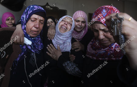 Palestinian Women Cry During the Funeral of Audi Naser who was Killed in an Israeli Air Strike During His Funeral in Beit Hanun Northern Gaza Strip on 16 November 2012 Missiles Continue to Be Fired on Israeli Targets by Palestinian Militant in the Gaza Strip As Israel Continues to Strike Targets in Retaliation Inside the Gaza Strip on the Second Day of Operation Pillar Cloud Following the Assassination of Hamas Militant Leader Ahmed Jabari Israeli Forces Launched a Heavy Barrage of Bombs at the Break of Dawn But Also Announce a Three Hours Ceasefire During the Visit of the Egyptian Prime Minister Hesham Qandil in the Gaza Strip - Gaza Strip