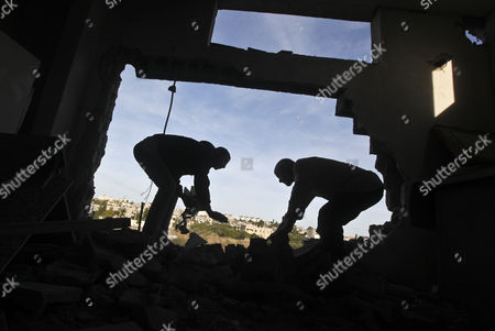 A Palestinian People Inspect the Damage to a Mosque After an Israeli Airstrike in Beit Hanoun North Gaza Strip on 16 November 2012 Reports State That Missiles Continue to Be Fired on Israeli Targets by Palestinian Militant in the Gaza Strip As Israel Continues to Strike Targets in Retaliation Inside the Gaza Strip on the Second Day of Operation Pillar Cloud Following the Assassination of Hamas Militant Leader Ahmed Jabari Israeli Forces Launched a Heavy Barrage of Bombs at the Break of Dawn But Also Announce a Three Hours Ceasefire During the Visit of the Egyptian Prime Minister Hesham Qandil in the Gaza Strip - Gaza Strip