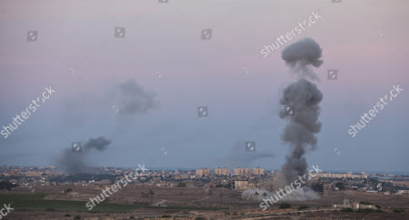 Smoke and Explosions Seen As a Bomb Dropped by Israeli Warplanes Explodes at a Alleged Position of Hamas Extremists in the Northern Gaza Strip 16 November 2012 Israeli Forces Launched a Heavy Barrage of Bombs at the Break of Dawn But Also Announce a Three Hours Ceasefire During the Visit of the Egyptian Prime Minister Hesham Qandil in the Gaza Strip Israel Gaza Border