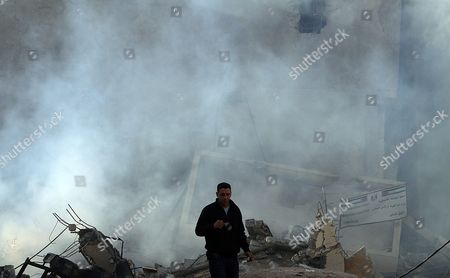 A Palestinian Man Inspects the Destroyed Hamas Ministry of Interior Building After an Israeli Air Strike in Gaza City on 16 November 2012 Missiles Continue to Be Fired on Israeli Targets by Palestinian Militant in the Gaza Strip As Israel Continues to Strike Targets in Retaliation Inside the Gaza Strip on the Second Day of Operation Pillar Cloud Following the Assassination of Hamas Militant Leader Ahmed Jabari Israeli Forces Launched a Heavy Barrage of Bombs at the Break of Dawn But Also Announce a Three Hours Ceasefire During the Visit of the Egyptian Prime Minister Hesham Qandil in the Gaza Strip - Gaza City