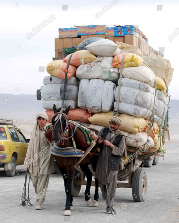 Afghan Men Lead a Horse Cart As They Cross Into Pakistan Through Chaman Border Pakistan 06 December 2012 Pakistani Foreign Minister Hina Rabbani Khar on 03 December Urged Nato and Its Allies not to Leave Behind a 'Security Vacuum' in Neighboring Afghanistan As They Prepare to Withdraw Their Combat Troops From the Country in 2014 Pakistan Chaman