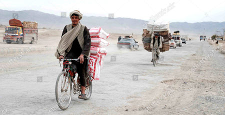 Afghan Men on Bicycles Cross Into Pakistan Through Chaman Border Pakistan 06 December 2012 Pakistani Foreign Minister Hina Rabbani Khar on 03 December Urged Nato and Its Allies not to Leave Behind a 'Security Vacuum' in Neighboring Afghanistan As They Prepare to Withdraw Their Combat Troops From the Country in 2014 Pakistan Chaman