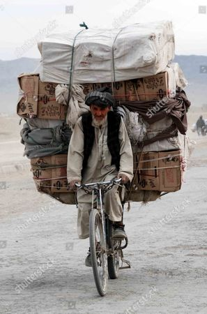 An Afghan Man on a Bicycle Crosses Into Pakistan Through Chaman Border Pakistan 06 December 2012 Pakistani Foreign Minister Hina Rabbani Khar on 03 Dcember Urged Nato and Its Allies not to Leave Behind a 'Security Vacuum' in Neighbouring Afghanistan As They Prepare to Withdraw Their Combat Troops From the Country in 2014 It Has Believed That Pakistan Holds the Key to Any Afghan Reconciliation Bid with the Taliban Due to the Historic Links of Its Premier Spy Agency Inter-services Intelligence (isi) with the Militants But Khar Insisted That There was No 'Covert Or Overt Support' to the Taliban's Haqqani Network Which Has Operated out of Pakistan and is Believed to Have Ties to Isi Pakistan Chaman