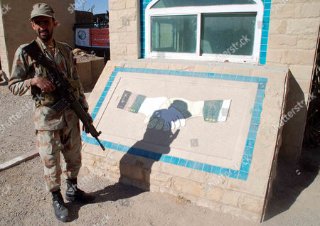 An Armed Pakistani Security Official Stands Guard at a Check Post on the Border Crossing with Afghanistan in Chaman Pakistan 11 December 2012 Pakistani Foreign Minister Hina Rabbani Khar on 03 December Urged Nato and Its Allies not to Leave Behind a 'Security Vacuum' in Neighboring Afghanistan As They Prepare to Withdraw Their Combat Troops From the Country in 2014 Pakistan Chaman